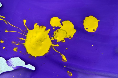 artistry: violet gouache paint and a yellow blotch in the middle close-up. Abstract background purple and yellow liquid paint. Artistry, art, creativity, Stock Photo