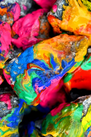 originative: stones with colorful paint. Abstract background colored stones randomly in different colors