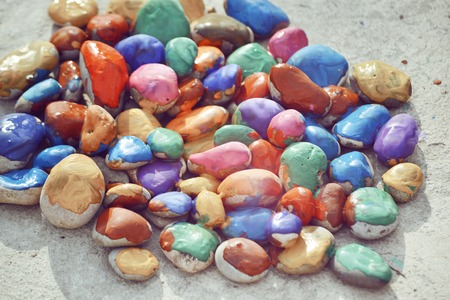 improvisation: Abstract creative background close-up. Stones with a smooth surface painted with colorful paint