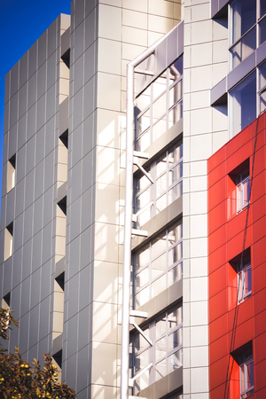 idealistic: facade, front of the house red and gray in the high-tech style different details on a bright sunny day