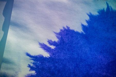 slur: ink spot spreads on paper blue color