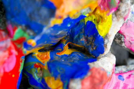 originative: Abstract Background Bright Colored Stones With Paint, Bizarre to Spread Paint on the Surface