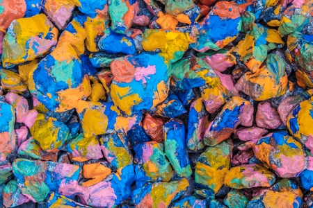 spot the difference: many stones in colorful paint abstract background