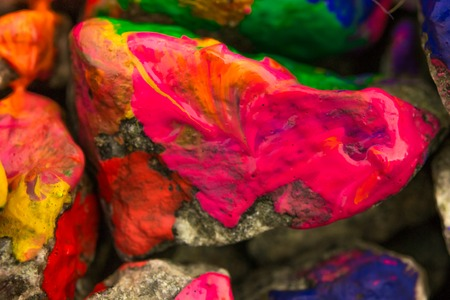 originative: the paint on the surface of the stone, close up