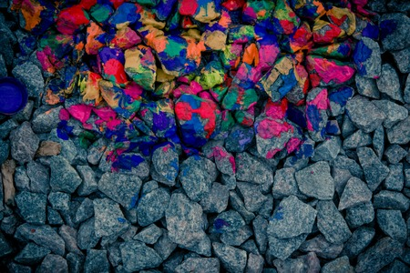 colorific: background dark gray stones and rocks in colorful neon colors, view from above Stock Photo