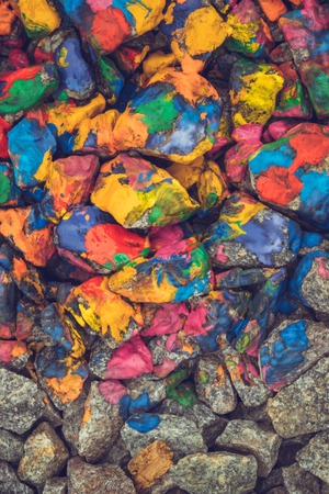 colorific: stones with colorful ink spots, view from above