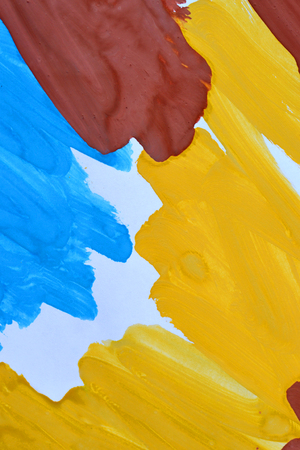 abstract background brush strokes yellow, brown, blue ink on white paper close-up Stock Photo