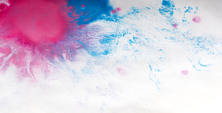 smudgy: colorful blots on white paper close up abstract background