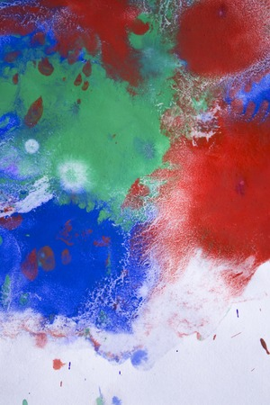 emotionality: red, blue, green ink droplet spreads on paper Stock Photo