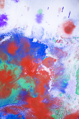unstructured: red and blue blurred ink stains on white paper