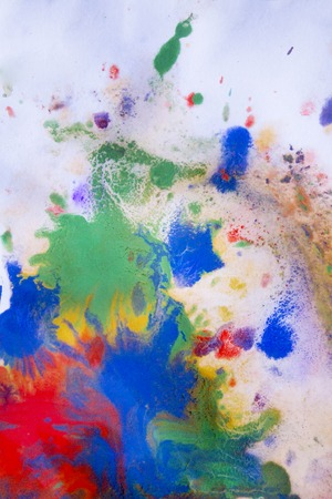 red, blue, green and yellow colors on paper conveyed over