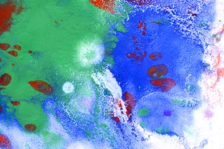 dissolve: background green and blue spots on the paper with red drops