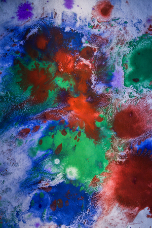 paintbucket: drops with streaks of different colors of paint are mixed