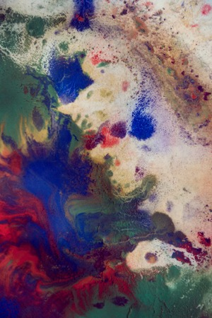 spot the difference: Drops with streaks of different colors of paint are mixed and absorbed. Abstract paint stains on white paper Stock Photo