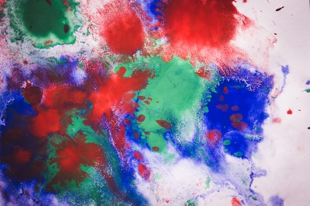 Abstract background with blots and spreads droplets of different colors on paper close-up, filter Stock Photo