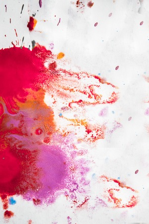 Abstract background of blots pink, red and maroon color with streaks and splashes on white paper