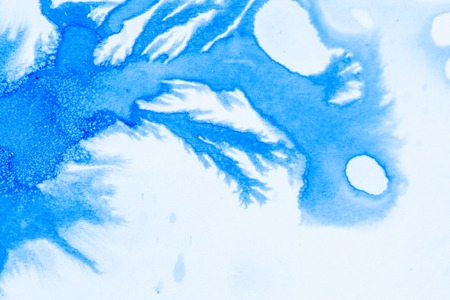 Ink blue drops and splatters on white background
