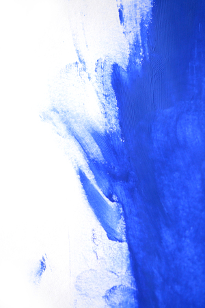 smears: uncertain chaotic backdrop. strokes of blue paint made by a finger. blue finger smears on a white background isolated. abstract background space for text base