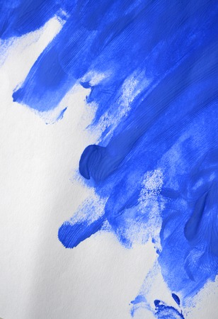 swabs of blue paint made by a finger Stock Photo