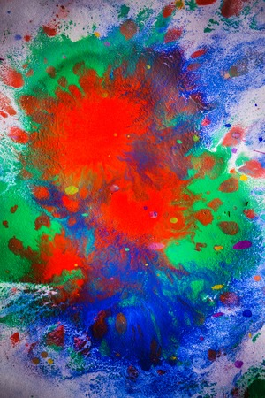 explosive emotional drops of bright red, green, blue on white paper