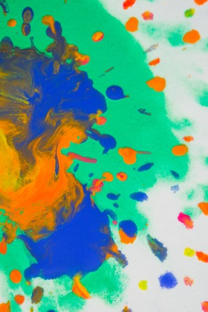 Whirlwind vortex spreads colored ink colors on white background. Abstractly spreads dye ink red, green, yellow, orange, blue background on paper. Art Creative abstract background. Colorful background Stock Photo