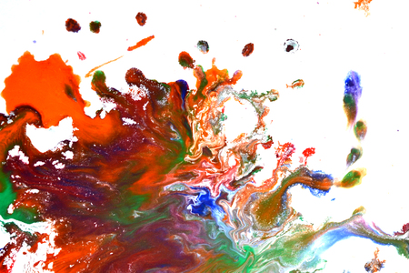 Isolated large patches spots blots of splash of mixed colors on a white background. Divorces and paint drips red, orange, yellow, blue blurred abstract background on a white paper background surface Stock Photo