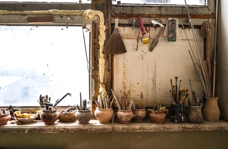windowsill: windowsill on which stand in vases tools in pottery