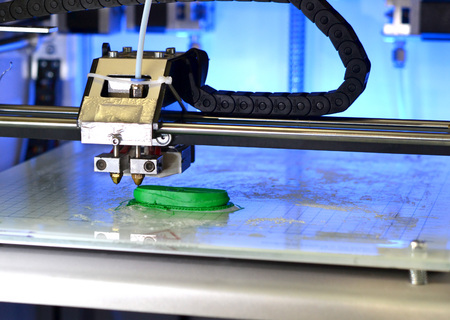 customizable: 3D printer prints the form of molten plastic green close-up. Automatic three dimensional 3d printer performs plastic modeling in laboratory. Progressive modern additive technology