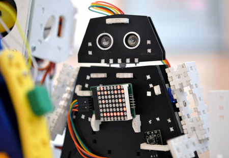 Toy robots prototypes close-up concept automation background Stock Photo