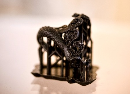 printed material: Objects photopolymer printed on a 3d printer. Black ring. Stereolithography 3D printer, technology of liquid photopolymerization under UV light