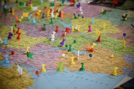 Geographic map with many colorful pins macro