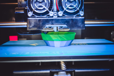 printout: 3D printer working and creating an object from hot  plastic close-up. Automatic three dimensional 3d printer performs plastic modeling prototype. Additive technologies 4 industrial revolution