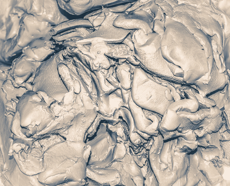 work path: Wet white clay closeup. Abstract pieces of wet clay on the table