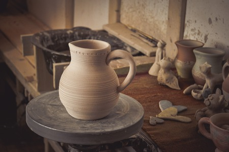 antique vase: Clay jug on a potters wheel close-up. Copy spase Stock Photo