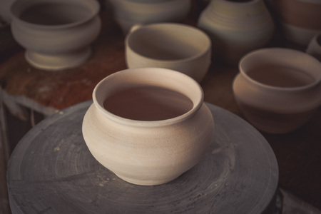 antique vase: Clay pot on a potters wheel close-up. Copy spase Stock Photo
