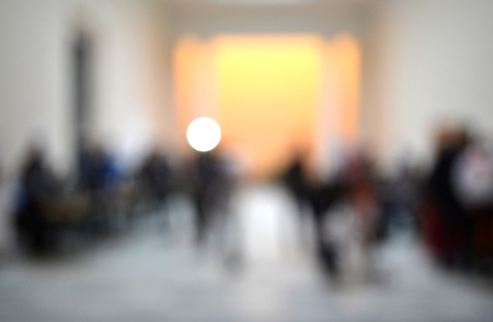 Many people Inside the building. Blurred background. Bokeh. Copy spase, space for text. Stock Photo
