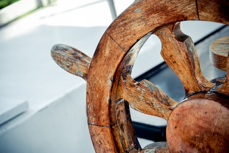 eldest: Wooden and Vintage old Steering wheel Handwheel ship close up Stock Photo