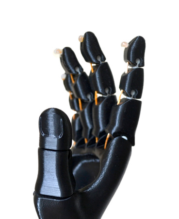 Robot hand fingers from plastic. Isolated on white background. Automatic three dimensional performs plastic modeling. Modern 3D printing technology.