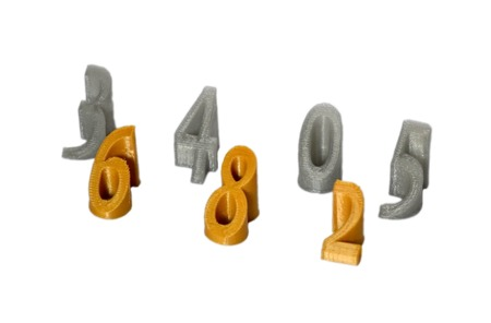 Objects printed by 3d printer Isolated on white background. The figure is numerals. Progressive modern additive technology. Concept of 4.0 industrial revolution