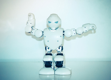 Small cyborg robots, humanoids with face, luminous eyes, body dances and makes different movement of hands, feet to music. Artificial Intelligence. AI. Smart robot.Concept of 4.0 industrial revolution Stock Photo