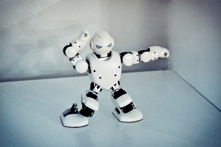 Small cyborg robots, humanoids with face, luminous eyes, body dances and makes different movement of hands, feet to music. Artificial Intelligence. AI. Smart robot.Concept of 4.0 industrial revolution Zdjęcie Seryjne