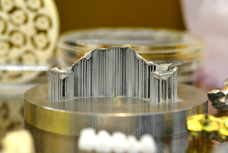 Object with supports created on a laser sintering machine on the work disk. 3D printer printing metal. Modern additive technologies 4.0 industrial revolution Stock Photo