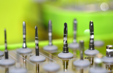 dentalcare: many dental drills different sizes and thicknesses close-up