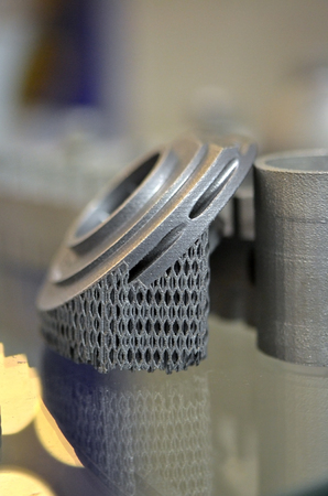 Object printed on metal 3d printer. A model created in a laser sintering machine close-up. DMLS, SLM, SLS technology. Concept of 4.0 industrial revolution. Progressive modern additive technology. Stock Photo