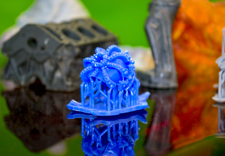 Objects photopolymer printed on a 3d printer. Stereolithography 3D printer, technology of liquid photopolymerization under UV light. Progressive modern additive technology 3D printing. Stock Photo