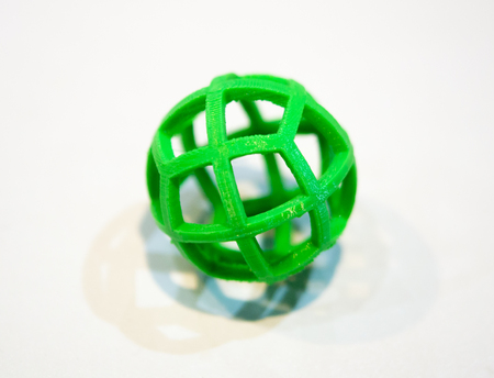 deposition: Abstract object of a green color printed by 3d printer on white background. Fused deposition modeling, FDM. Progressive modern additive technology. Concept of 4.0 industrial revolution