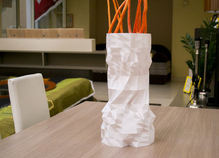 A large tall white vase printed with a 3d printer stands on a table close-up. Progressive modern additive technologies 4.0 industrial revolution