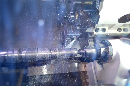 Lathe inside close-up. Industrial production heavy machinery.