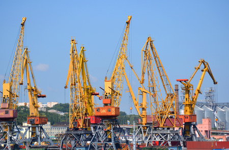 yellow cranes for lifting cargo at the sea port.  City Odessa, Ukraine 18 July 2013 Stock Photo