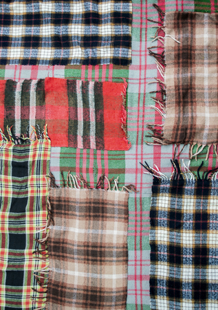background: quilt sewn with colored rags,scraps abstract Imagens